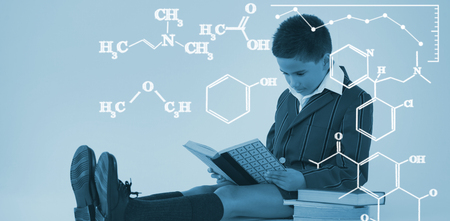 Digital image of chemical formulas against schoolboy reading book on white background