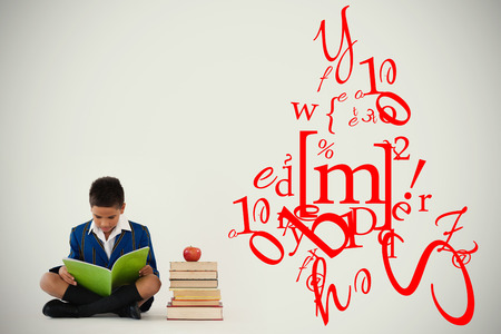 letter and number jumble against schoolboy studying against white background