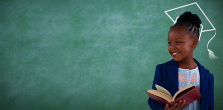 Graduation hat vector against businesswoman reading book against blackboard