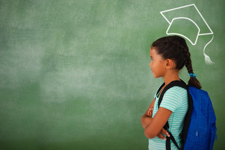 Graduation hat vector against young girl with her arms crossed against chalk board
