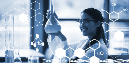 Graphic image of chemical structure against portrait of happy schoolgirl doing a chemical experiment in laboratory