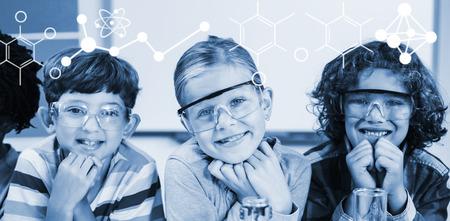 Illustration of chemical formulas against portrait of kids in laboratory Stock Photo