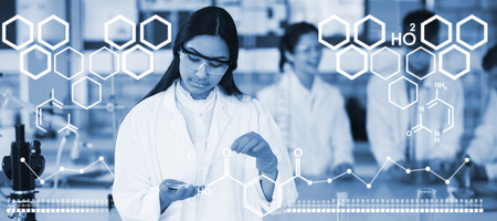Digital image of chemical structure against school girl experimenting with chemical in laboratory at school