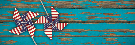 3D image composite of pinwheel with American flag pattern against horizontal wood panelling Stock Photo