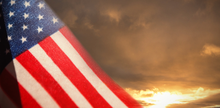 cytosine: Close-up of American flag against cloudy sky landscape