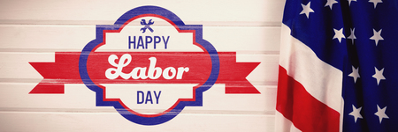 Digital composite image of happy labor day banner against close-up of an american flag