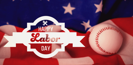 cytosine: Digital composite image of happy labor day banner against baseball ball on crumbled national flag Stock Photo