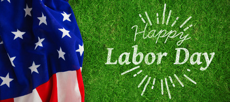 national identity: Digital composite image of happy labor day and god bless America text against closed up view of grass