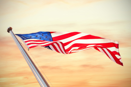 national identity: American flag against scenic view of sky during sunset