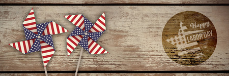 Digital composite image of happy labor day text on blue poster against wood panelling Stock Photo