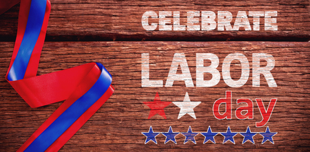 Celebrate labor day text and stars against red and blue ribbon on table