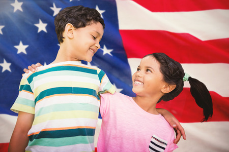 Happy friends against white background against close-up of us flag Stock Photo