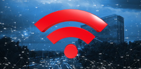 Red wifi symbol against cars moving on road in city at night Stock Photo