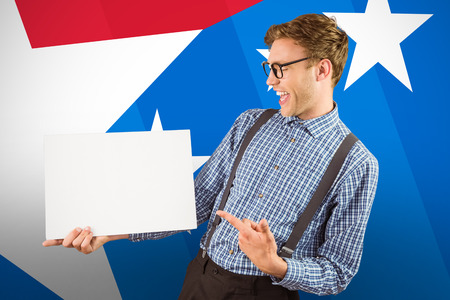 Geeky hipster showing a card against digital composite of american flag