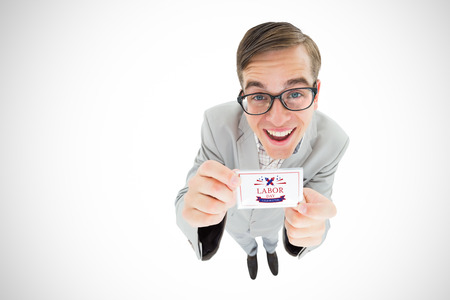 Geeky hipster smiling and showing card against digital composite image of labor day celebration text