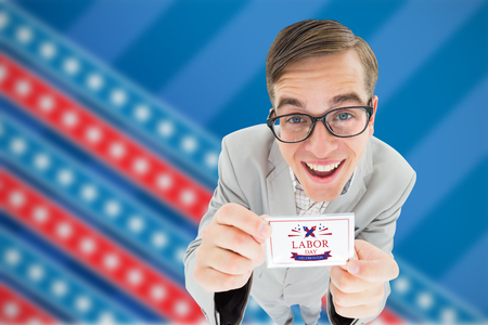 Geeky hipster smiling and showing card against focus on stars