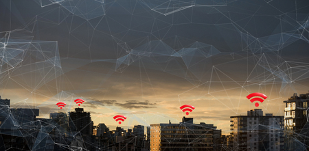 wireless communication: Red wifi symbol against city against cloudy sky during sunset