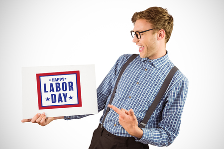 Geeky hipster showing a card against composite image of happy labor day poster