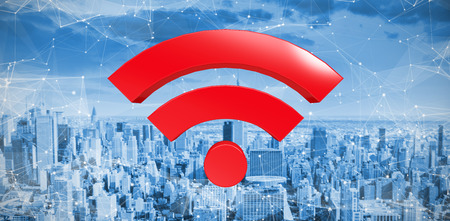 Red wifi symbol against high angle view of city by river