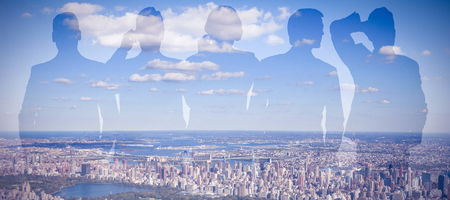 Vector image of business people against aerial view of new york