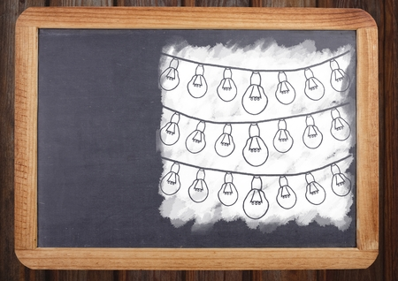 digitally generated image: Digital composite of light bulbs on blackboard