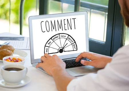 Digital composite of Comment text and ratings graphic on laptop screen with hands