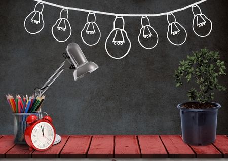 digitally generated image: Digital composite of Desk foreground with blackboard graphics of light bulbs