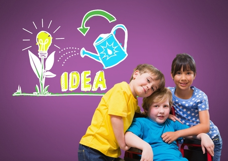 Digital composite of Disabled boy in wheelchair with friends with idea graphics Stock Photo
