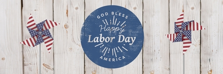 Digital composite of Happy labor day text and USA wind catchers in front of wood