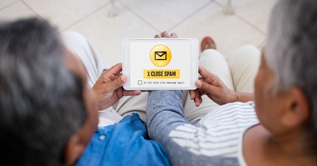 comfortable: Digital composite of Email spam on the screen