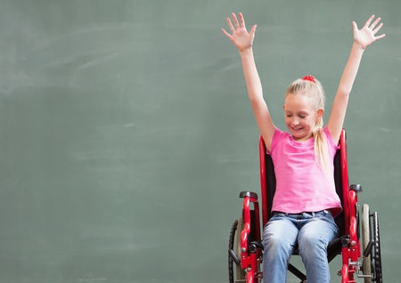 Digital composite of Disabled girl in wheelchair in front of blackboard Stock Photo