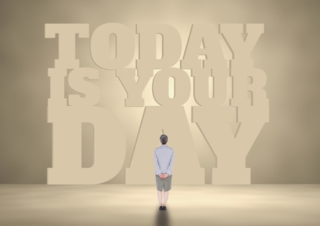 Digital composite of Business woman standing in front of a motivational text Stock Photo