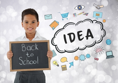 Digital composite of Boy holding back to school blackboard with idea graphics
