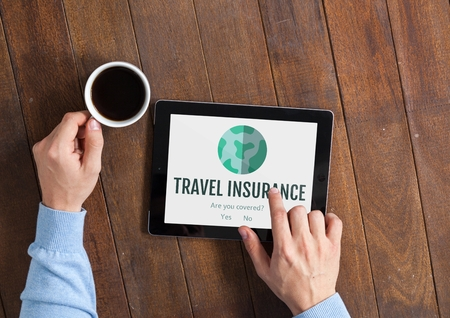 wireless communication: Digital composite of Man using a tablet with travel insurance concept on screen