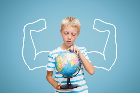 navigational light: Digital composite of Student boy with fists graphic holding a globe against blue background Stock Photo