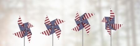 Digital composite of USA wind catchers in front of bright light Stock Photo