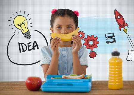 Digital composite of Girl at desk with healthy lunch and idea graphics Stock Photo