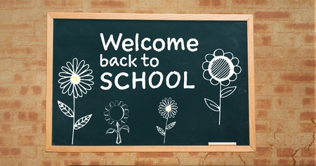 digitally generated image: Digital composite of Welcome back to school text and flowers  on blackboard