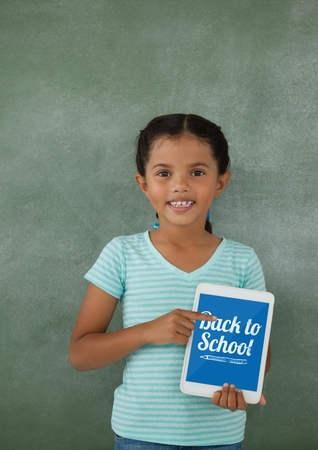 wireless communication: Digital composite of Girl holding a tablet with school icons on screen