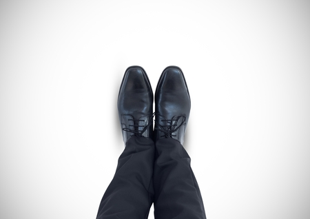 Digital composite of Black shoes on feet with white background