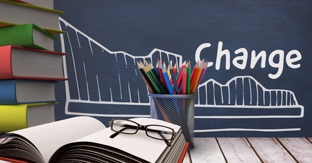 digitally generated image: Digital composite of Books on the table against blue blackboard with education and school graphics