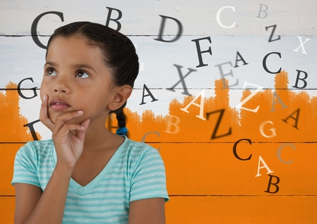 Digital composite of Many letters around Girl thinking in front of orange painted background