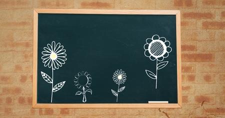 Digital composite of flowers on blackboard