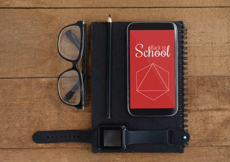 digitally generated image: Digital composite of Phone with school icons on screen