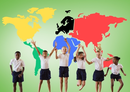 Digital composite of Multicultural Kids jumping in front of colorful world map 版權商用圖片