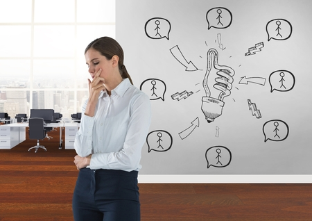 Digital composite of Business woman thinking in a 3D room with a conceptual graphic on the wall Stock Photo
