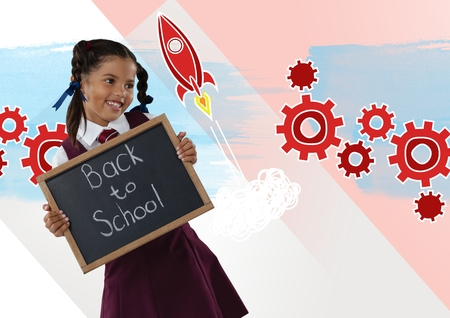 Digital composite of Girl holding blackboard with back to school text and rocket cogs graphics Stock Photo