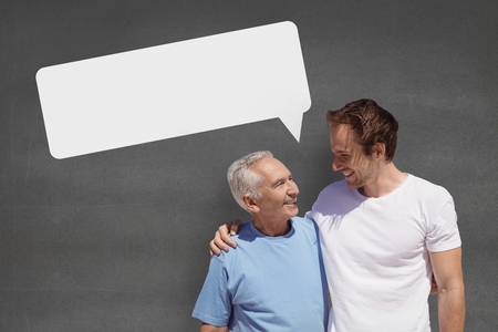 Digital composite of Father and son with speech bubble against grey background Banco de Imagens - 83947304