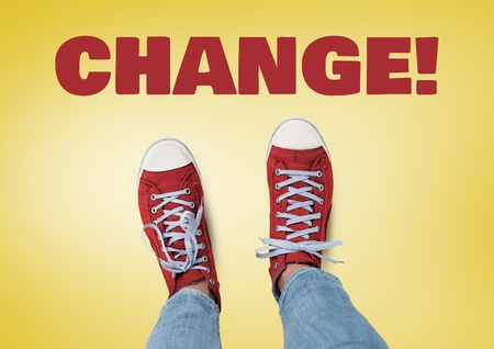 Digital composite of Change text and Red shoes on feet with yellow background