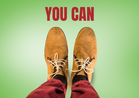 Digital composite of You can text and Brown shoes on feet with green background